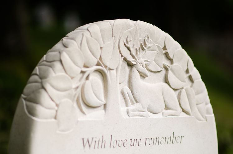 what is usually on a headstone? carving