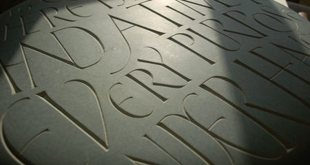hand carved lettering in stone