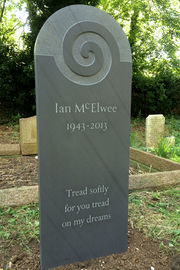 slate gravestone with carving of spiral