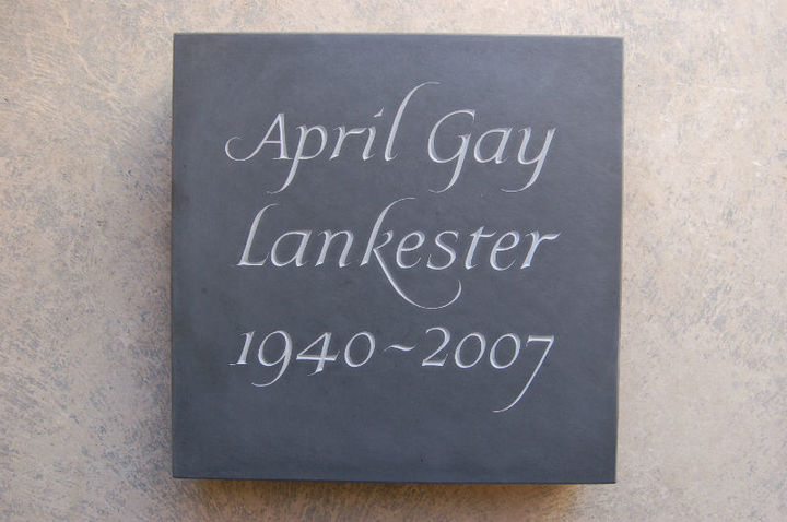 slate cremation memorial with simple painted lettering
