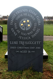 hand carved slate headstone with golden apples