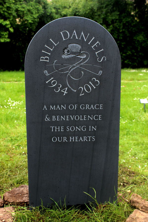 bespoke slate headstone with carving in circle
