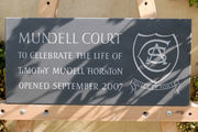 slate memorial stone with crest line carving