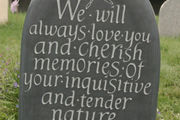back of pebble baby memorial stone with free lettering