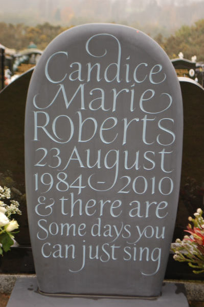 This is a bespoke slate headstone shaped by hand into a pebble