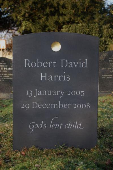 children's gravestones with sunken disc