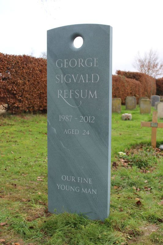 headstone for young person carved by hand from green slate