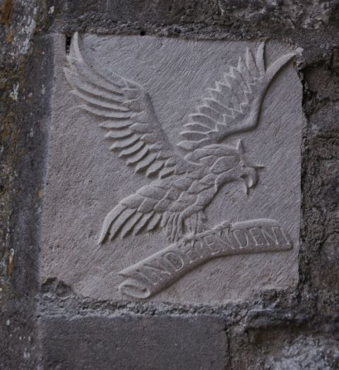 The Independent Eagle carved into stone