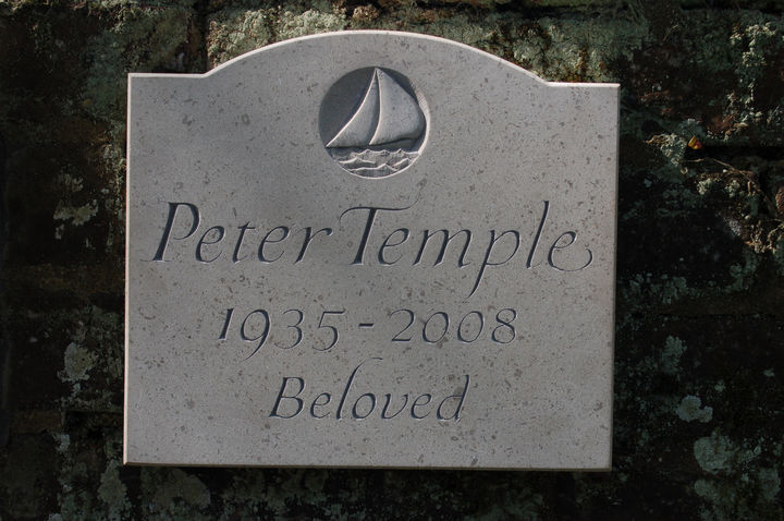 memorial plaque with boat carving
