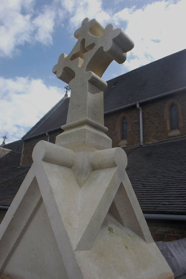 Masoned cross on Esher Church, restored by Stoneletters