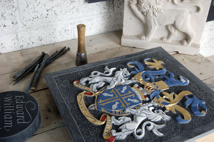 coat of arms for Lord Butler of Brockwell carved in slate and painted