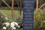 garden obelisk in slate with poem