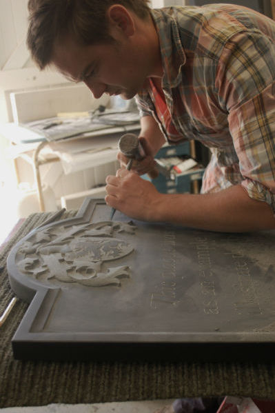 Fergus Wessel carving a headstone