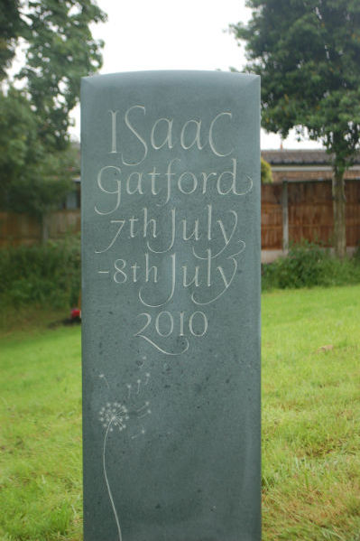 green slate headstone for a child