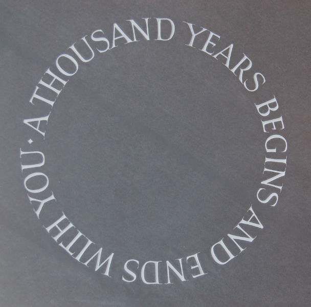 circular lettering on a gravestone