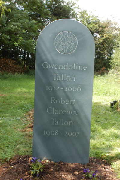green slate headstone with oak tree carving