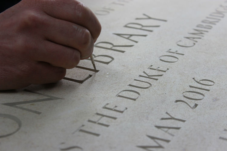 painting lettering in stone