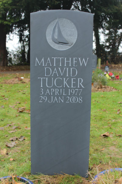 Slate headstone with carving