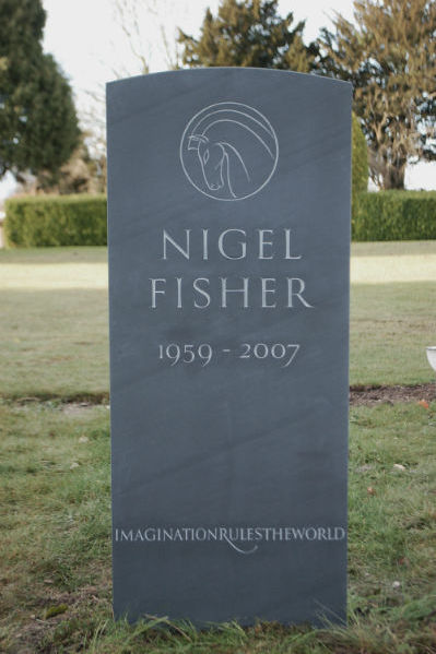 slate headstone with line carving of horse
