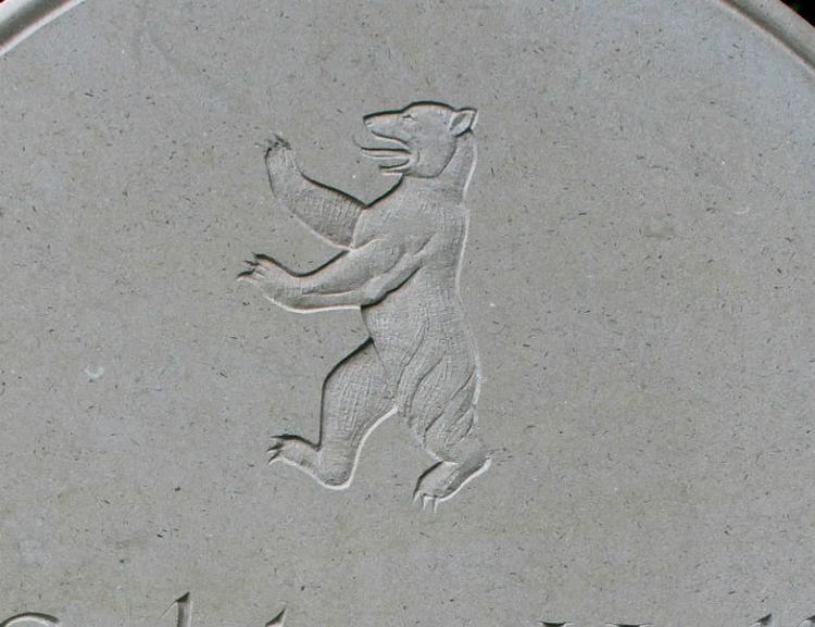 symbol of bear on gravestone