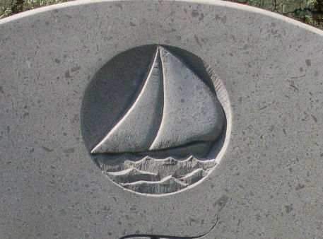 boat carved in relief on headstone