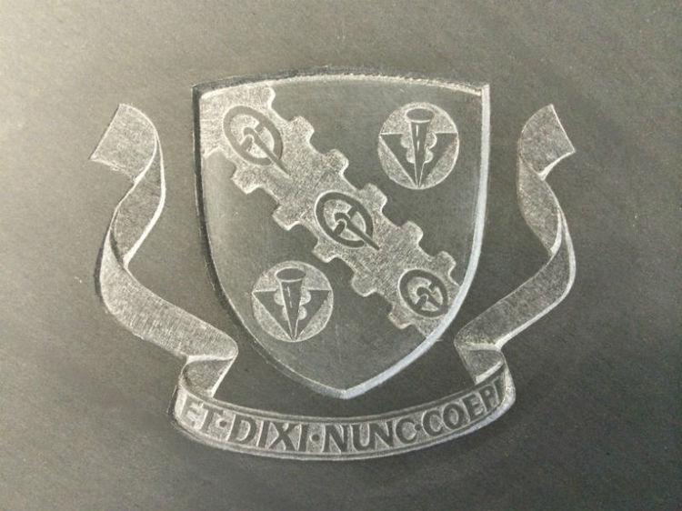 crest on slate headstone