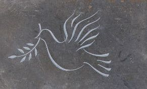 line carving of dove on slate headstone