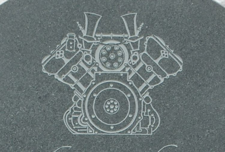 engine carved onto headstone