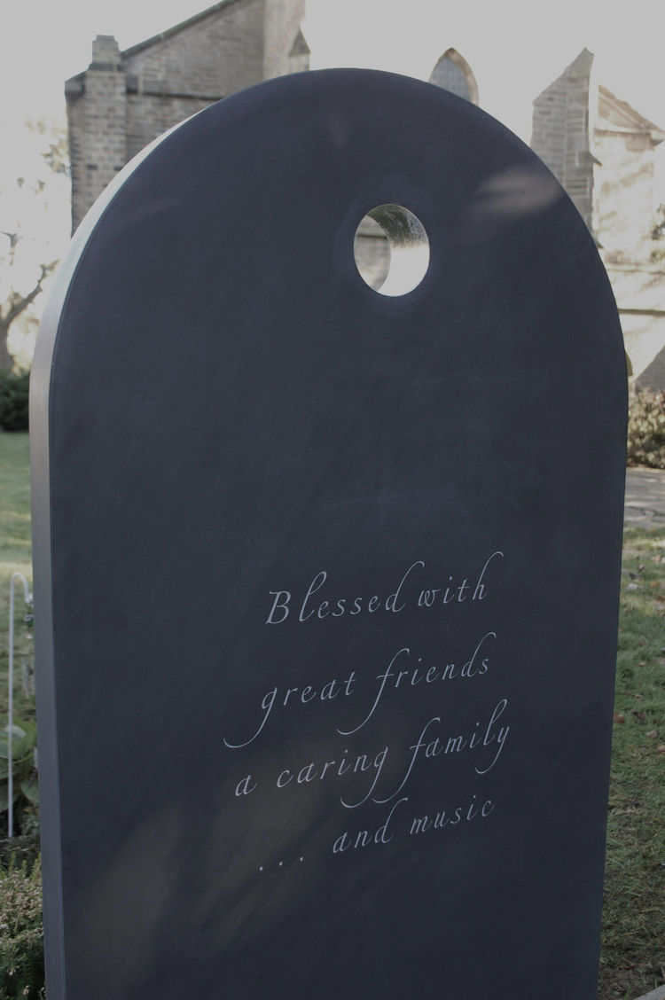 Hand carved headstone in slate