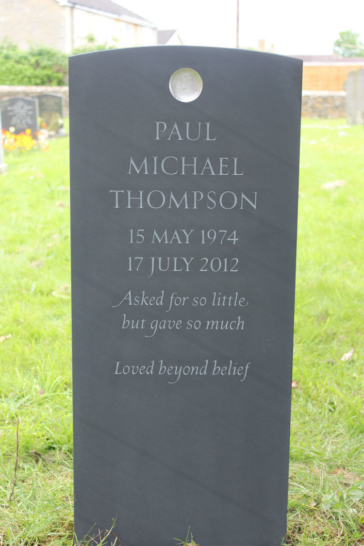 Beautiful slate headstone with disc