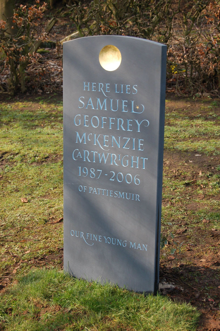 Slate headstone with disc