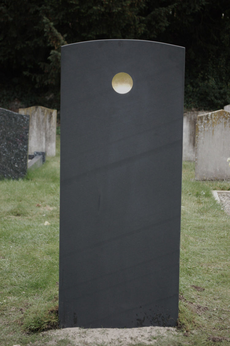 Gold disc on headstone