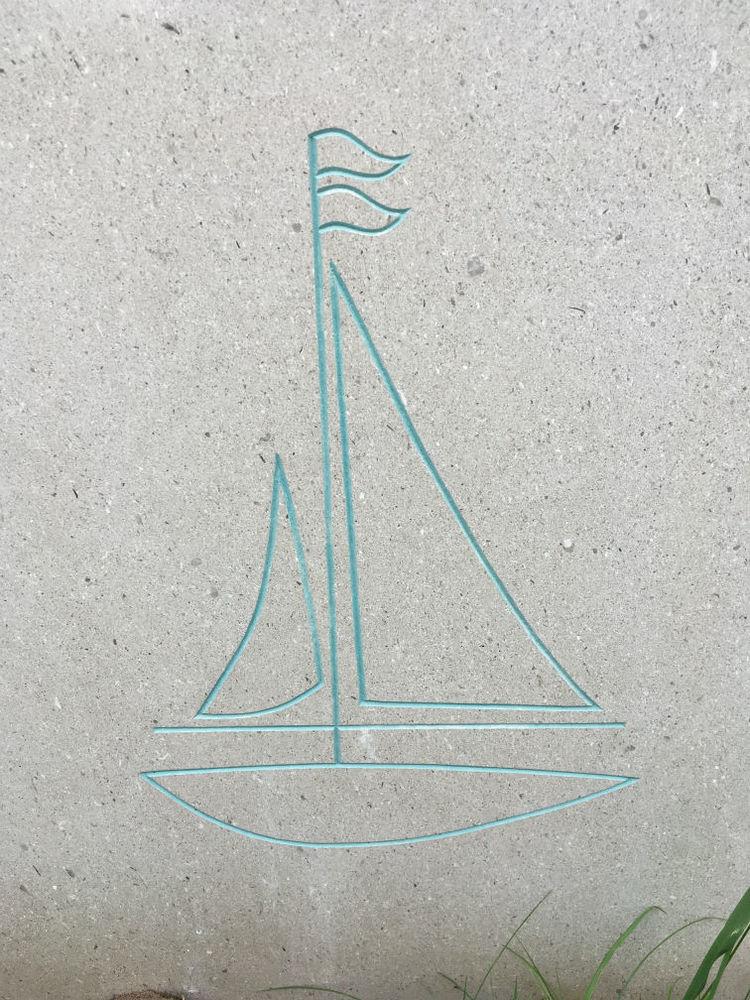 Boat gravestone carving