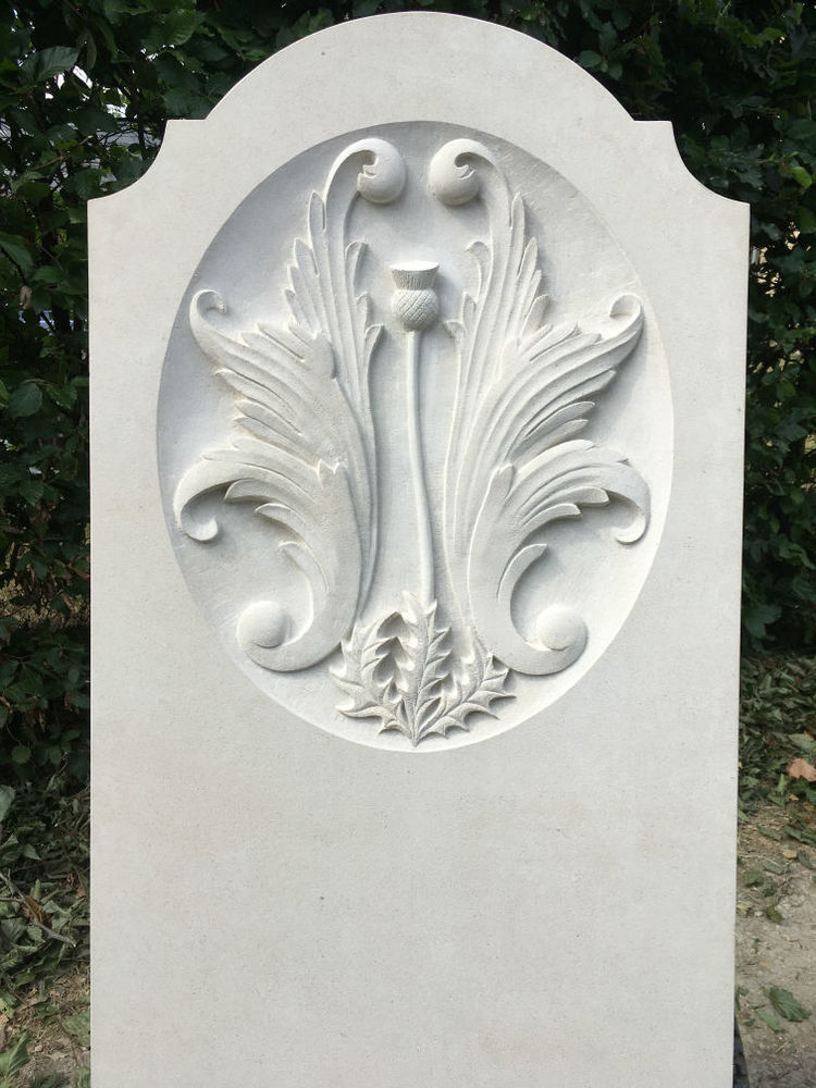 headstone with carving in portland limestone