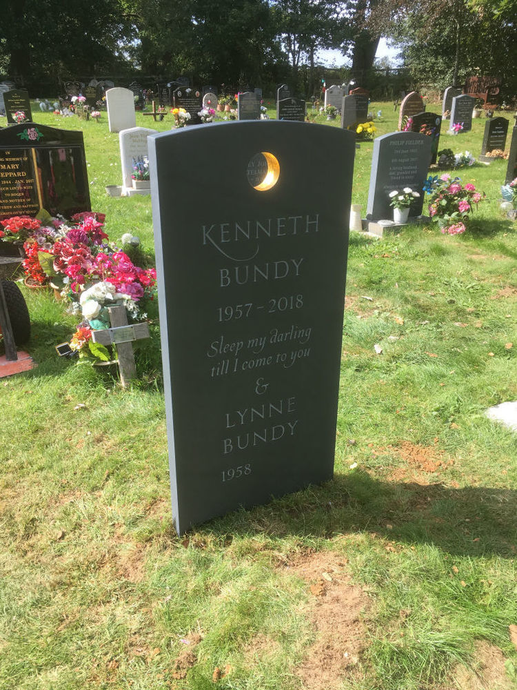 Unique slate headstone with golden circle