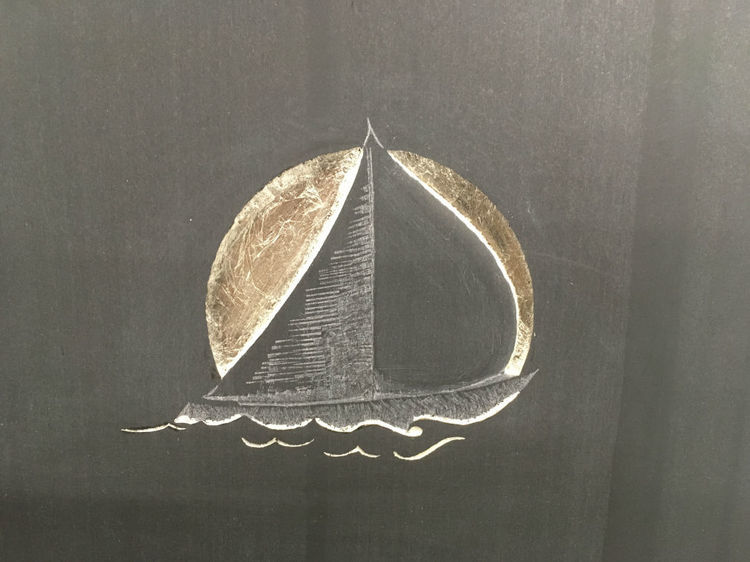 Carving of boat on headstone