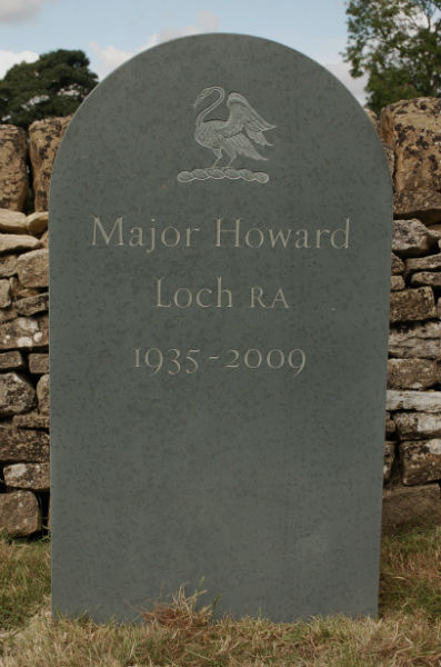 green slate headstone with relief carving