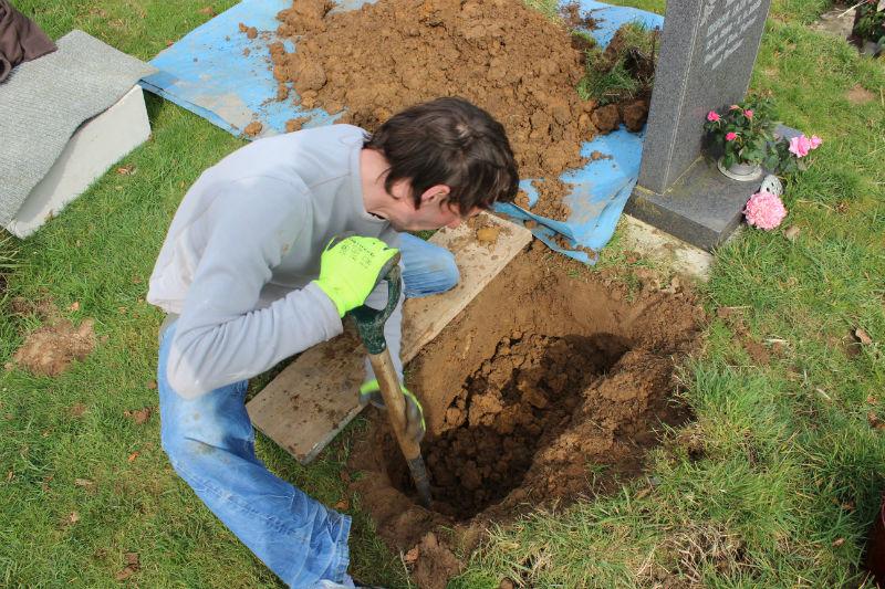digging gravestone hole