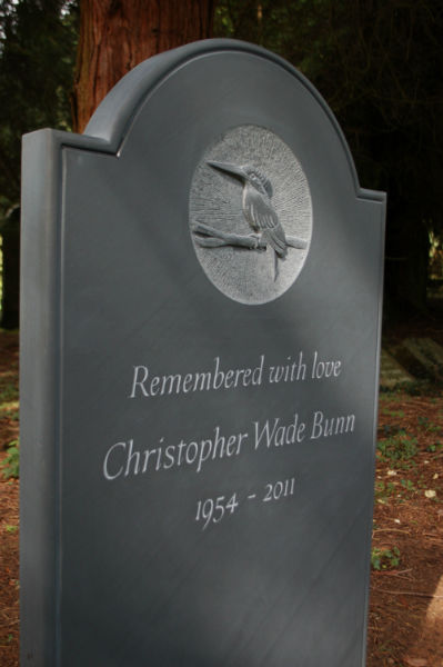 slate headstone with relief carving