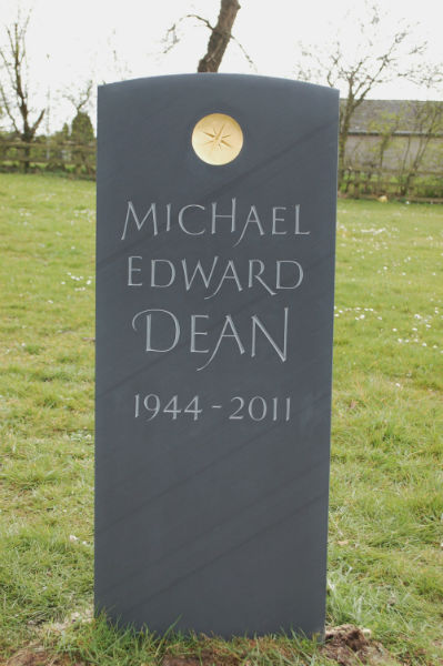 hand carved memorial with gilded sunken disc
