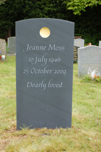 hand made headstone with gilded disc