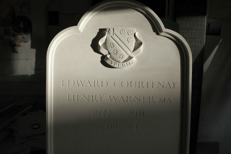 crest on portland gravestone
