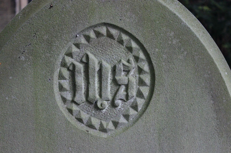 ihs symbol on gravestone