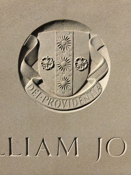 crest on limestone headstone