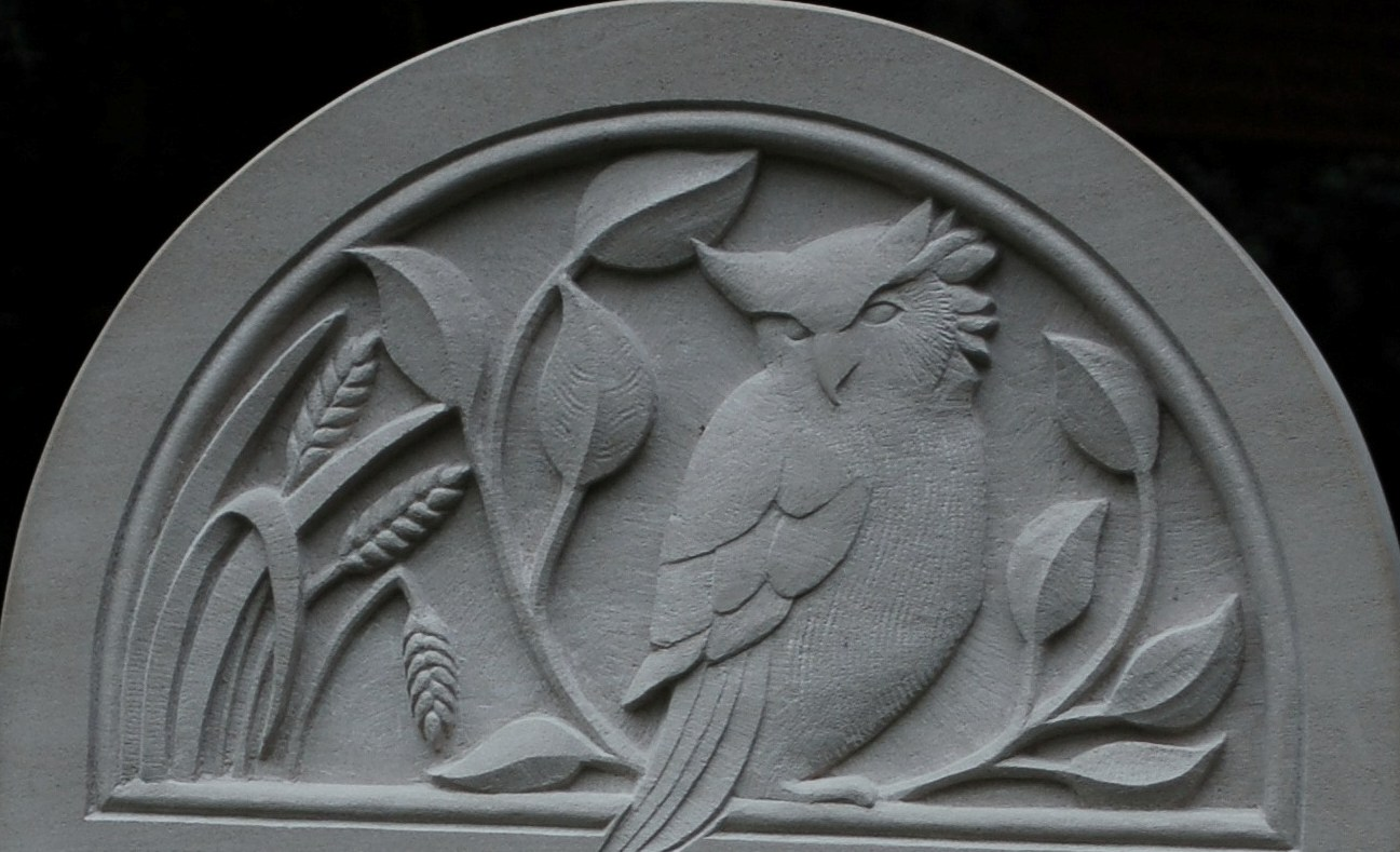 relief carving of owl on portland headstone