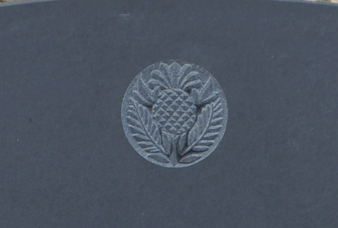 thistle symbol on gravestone